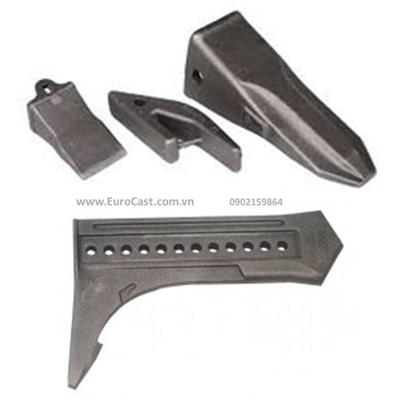 Investment casting of agriculture machine structures
